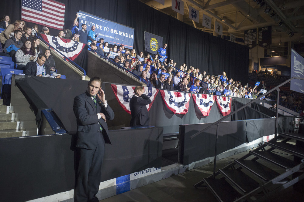 Secret Service surveys the venue before the candidate enters.