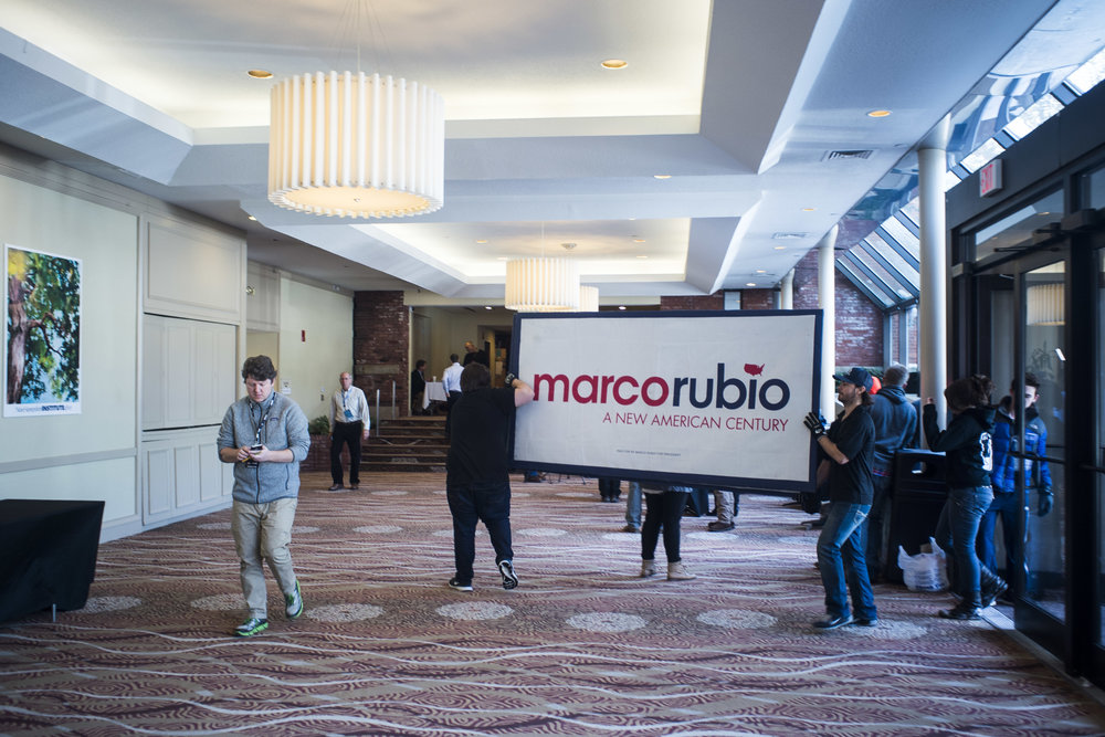 Campaign staff carries in signage for Senator Marco Rubio (R-FL) into the Manchester Radisson.