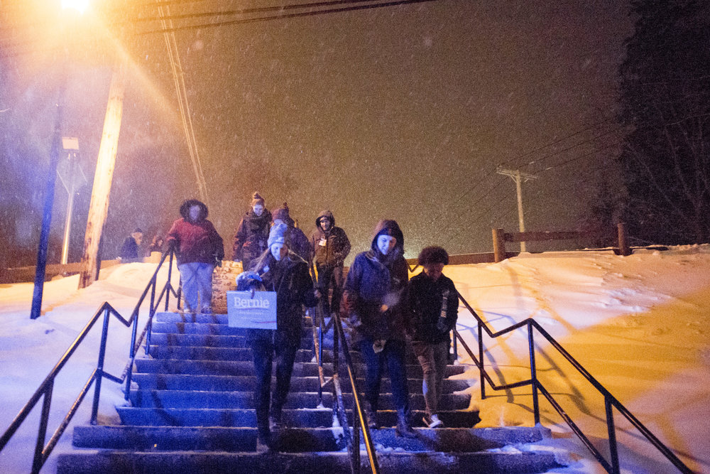 Sanders supporters head through the snow back to the parking lot following the rally.