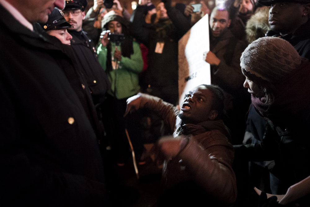 Demonstrators confront police outside the Atlantic Terminal shopping center on December 8th, 2014. Weeks of protest followed a Staten Island grand jury's decision on December 3rd 2014 not to indict Officer Daniel Pantaleo in the killing of Eric Garner.