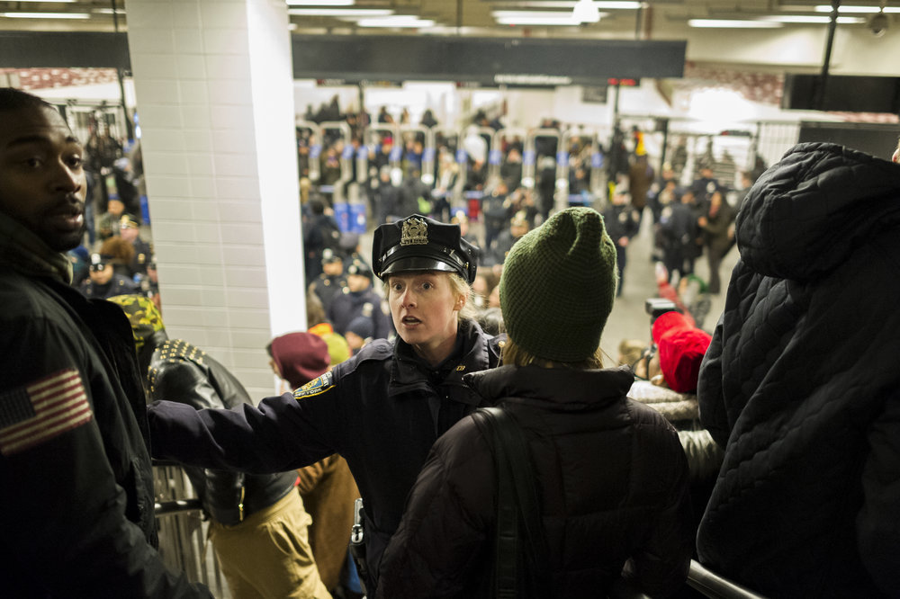 Police push back a line of demonstrators at the Barclays Center subway station on December 8th, 2014. Weeks of protest followed a Staten Island grand jury's decision on December 3rd 2014 not to indict Officer Daniel Pantaleo in the killing of Eric Garner.