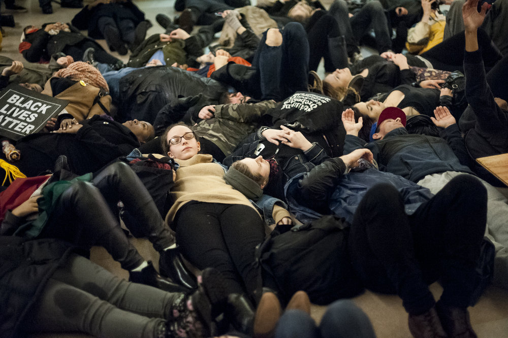 "Demonstrators take part in a ""die-in"" in the main atrium of Grand Central Station on December 6th, 2014. Weeks of protest followed a Staten Island grand jury's decision on December 3rd 2014 not to indict Officer Daniel Pantaleo in the killing of Eric Garner."