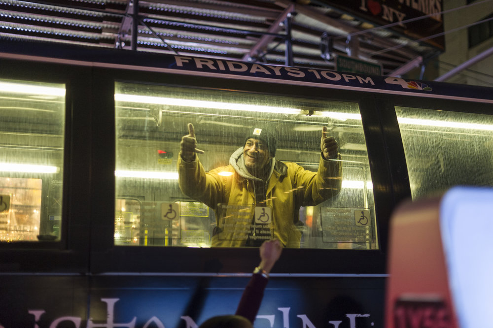 A passenger on an MTA bus reacts to the November 25th 2014 protest of a St. Louis grand jury's decision not to indict Officer Darren Wilson in the killing of Michael Brown.