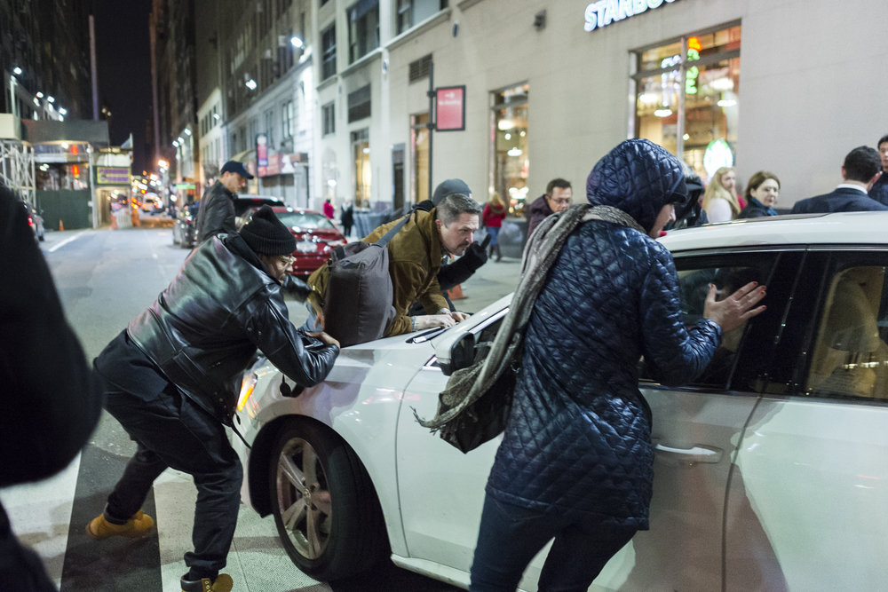 Demonstrators confront a driver who was attempting to break through a protest on December 4th, 2014. Weeks of protest followed a Staten Island grand jury's decision on December 3rd 2014 not to indict Officer Daniel Pantaleo in the killing of Eric Garner.