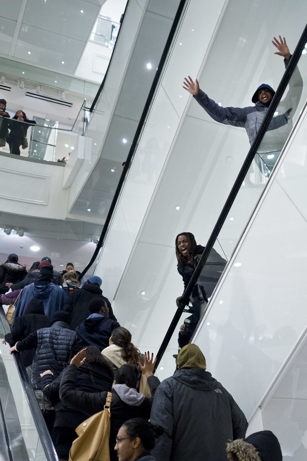 Demonstrators march through multiple floors of Forever 21 in Times Square on December 6th, 2014. Weeks of protest followed a Staten Island grand jury's decision on December 3rd 2014 not to indict Officer Daniel Pantaleo in the killing of Eric Garner.