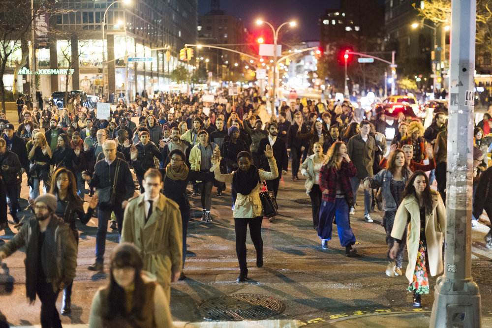 Protestors march east on Houston Street on November 25th 2014, after a St. Louis grand jury chose not to indict Ferguson Police Officer Darren Wilson in the killing of Michael Brown.