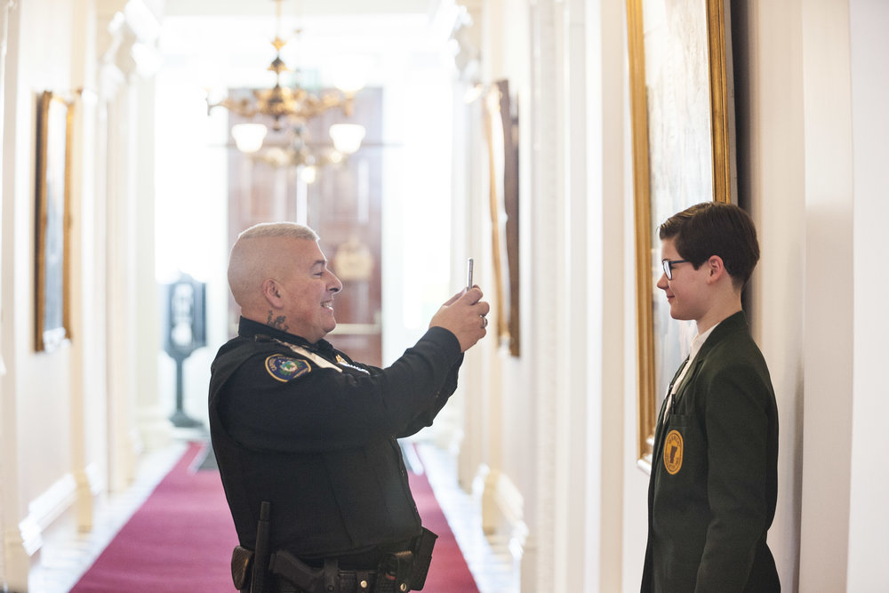Capitol Police officer Dale Manning snaps an ID photo of new Legislative Page Linnea Colwell of Montpelier as the State House prepares for the 2018 legislative session on Tuesday, January 2nd 2018.
