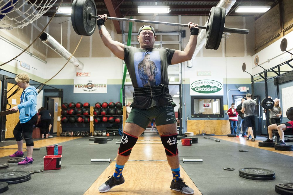 "Narin Phanthakhot of Colchester successfully completes a ""clean and jerk"" lift at Green Mountain Crossfit in Barre during their annual ""Lift Up!"" Fundraiser on Saturday, January 20th 2018."