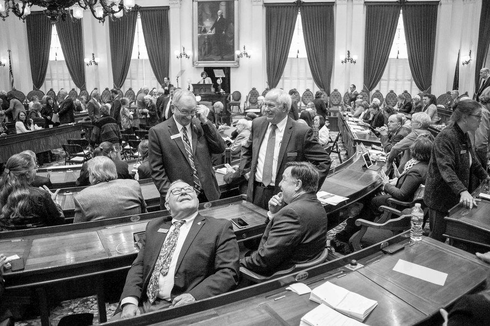 Representatives mingle before Governor Phil Scott delivers the fiscal year 2019 budget address in the House Chamber of the Vermont State House on Tuesday, January 23rd 2018.