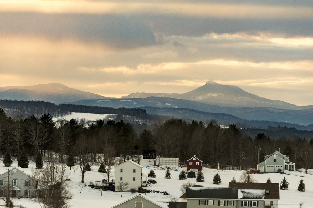 Camel's Hump mountain looms over Barre at sunset on Sunday, February 18th 2018.