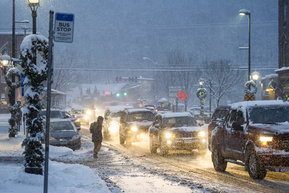Traffic on Main Street in Montpelier crawls along as Vermont is hit with the 2017-2018 winter's first significant snowfall on Tuesday, December 12th 2017.