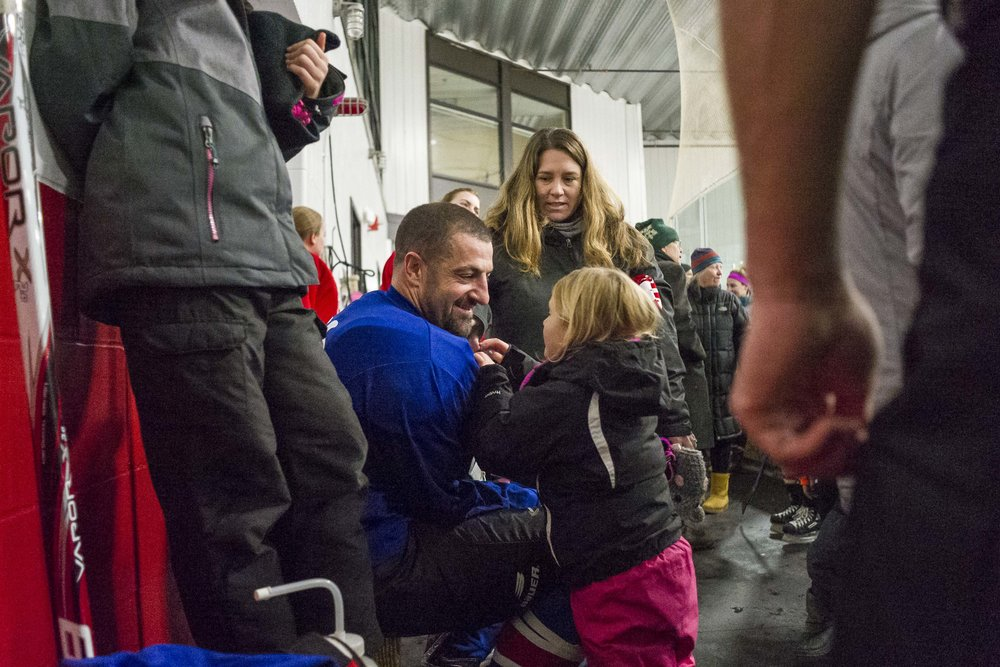 Spencer Pryce, a 1996 U-32 graduate, shares a moment with his daughter Zoe, 4, after the 25th annual Kris Kemp Alumni Hockey Games at the Central Vermont Memorial Civic Center on Tuesday, December 26th 2018.