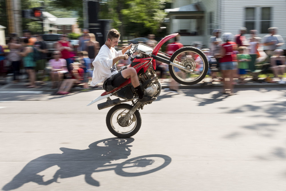 Noah Ladensack of Duxbury wows the crowd with a wheelie during the annual Not Quite Independence Day Parade in Waterbury on June 30th, 2018.