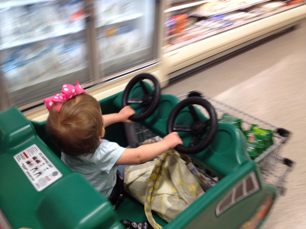 #BabyMadison driving the grocery cart