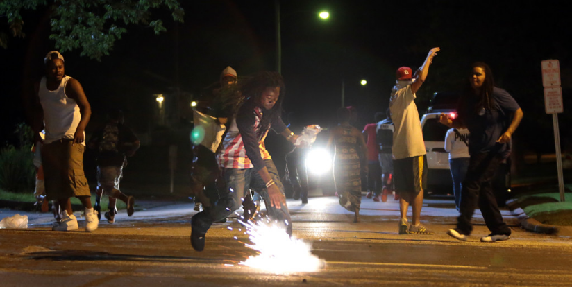 Edward Crawford in Ferguson   just after midnight on Aug. 13 taken by Post-Dispatch photographer Robert Cohen.