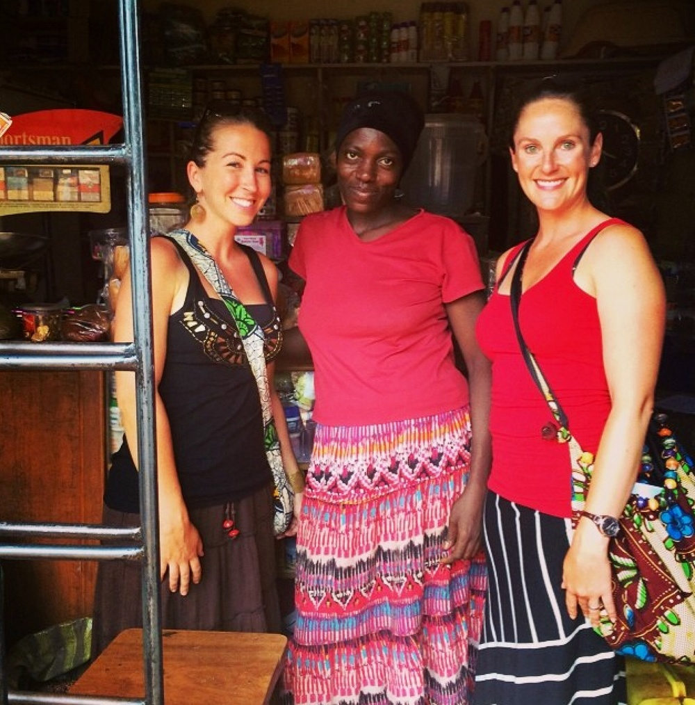 Roxanne and Brittany visiting a local shopkeeper who is a recipient of Silver Upholders, a micofinance company that provides small loans to women.