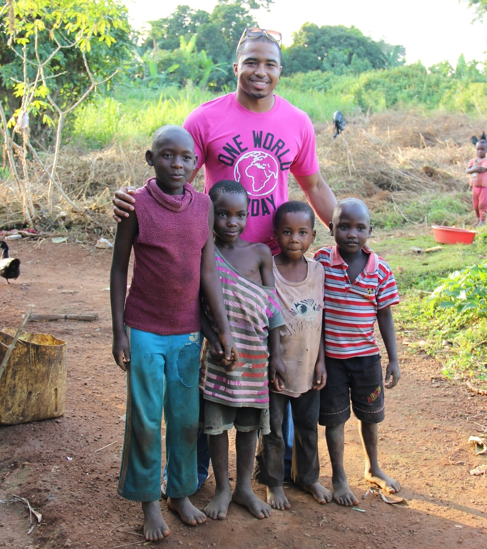 Jerome hanging out with the Ugandan kids in the area.