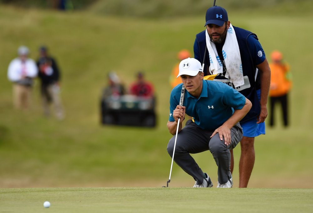 Jordan Spieth and his caddie, Michael Greller (Photo by Andy Buchanan/Agence France-Presse via Getty Images (in the Washington Post))