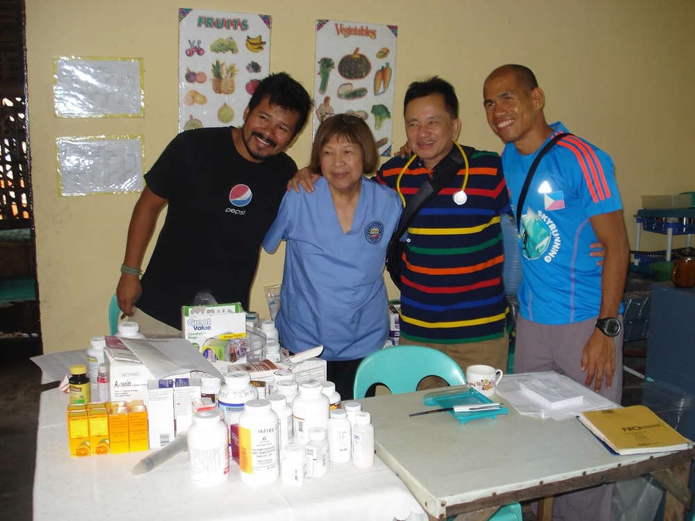 "Our pharmacy team: Eric Steiner, Peace Corps; Kay Yamagata, pharmacist; Ed Pangilinan, team administrator; ""Jun"" Ramirez, University of the Philiippines outreach team"