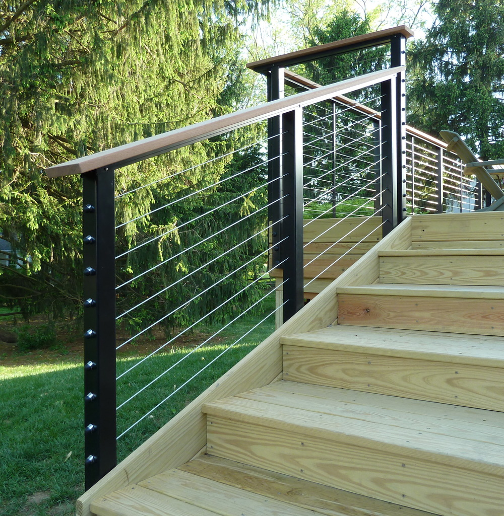 Usually you see spindles or slats of wood.  But look how clean this unusual deck railing is.  You can see your backyard.  A finishing touch to your deck that truly separates your home from the rest.