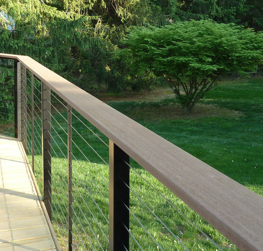 From the top, the railing helps to show off your backyard while creating an unusual finish to your deck.  Truly expands your home into the outdoors.  Perfect for entertaining!