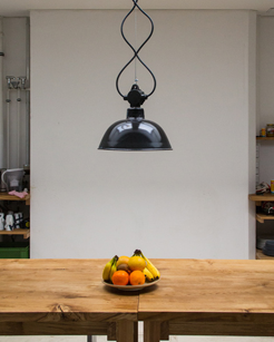 """Plants and trees grow through floors, rainfall has slowly eaten through ceilings, and even wildlife returns."" Kamiel and Martijn Blom rescue industrial fittings from forgotten places and give them new life."