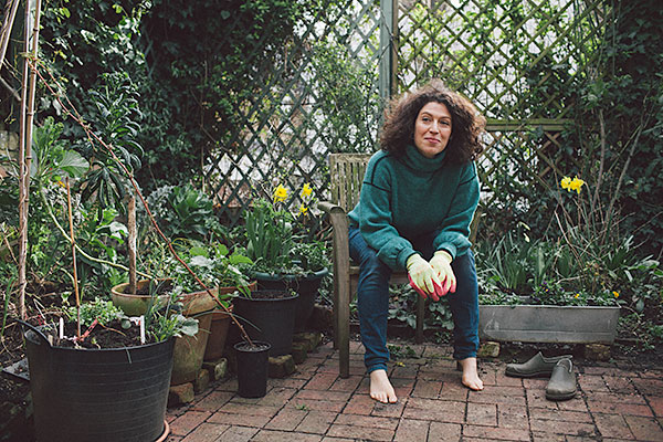 """Charlotte Mendelson is standing in the busily populated garden of her north London home reeling through lists of plants, many of which I've never heard of before. """"It's eccentric. It's not a garden that normal people have,"""" she laughs as she shows me various ephemera she has picked up on the street or recycled from the house: mixing bowls for plant pots, an old winemaking barrel full of comfrey steeping in water (an excellent home-made plant food) and a sledge propping up an Abutilon tree. But then Charlotte Mendelson is not your average gardener. We're meeting just a few days after her fourth novel,Almost English,has been longlisted for the Baileys Women's Prize for Fiction, a book she wrote on the two days a week she's not working as an executive editor at book publisher Headline. Add two children into the mix, and it's amazing she has any time to garden at all. """"It's the only thing for me that stops me thinking about anything else and that's why it's so mentally healthy. It turns off all the worry and the 'thinkiness' and you focus on the moment."""" As Mendelson takes me on a tour of her garden, pointing out burgeoning shoots of wild garlic, chervil, chicory, mizuna, dragon's tongue and a dozen other herbs and salad leaves, I realise that this isn't your typical shrubs-and-flowers style of gardening. """"I'm not interested in flowers because they're a waste of growing space. It's all about growing stuff I can eat. It's the stuff that makes my Sainbury's shop more interesting."""" In addition to herbs and salad leaves, she has an impressive collection of fruit trees, edible flowers and even a Hunza apricot seedling she has cultivated from a dried fruit stone. """"The main thing I do from the garden is I make salads. Often, I have to buy the main lettuce because I don't grow big lettuce but I'll grow 15 different kinds of little salad leaves – such as sorrel and rocket – and also lots of herbs and edible flowers. If you put flowers in salads, they look amazing. So if we have """