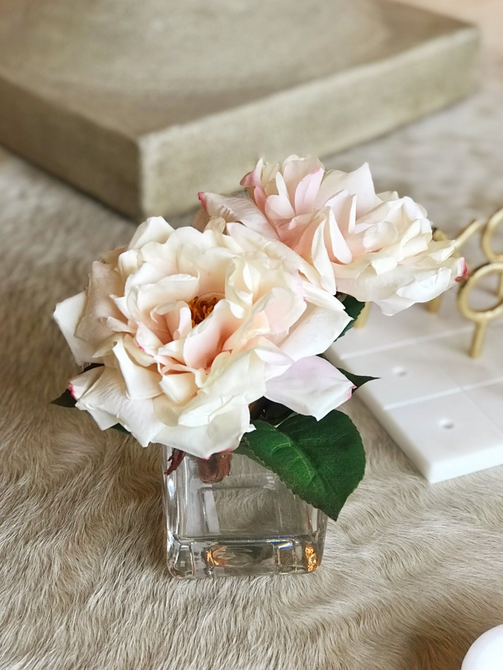 Faux roses in glass