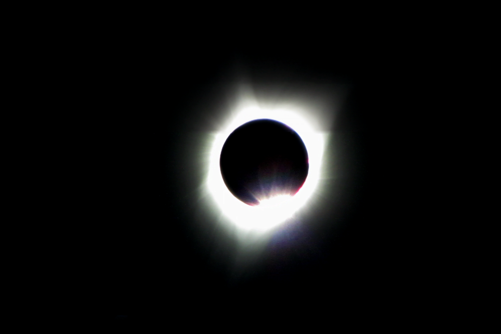 This image is a combination of 40 frames at 1080p during totality as well as 30 frames just before totality.  Canon PowerShot SX1 IS