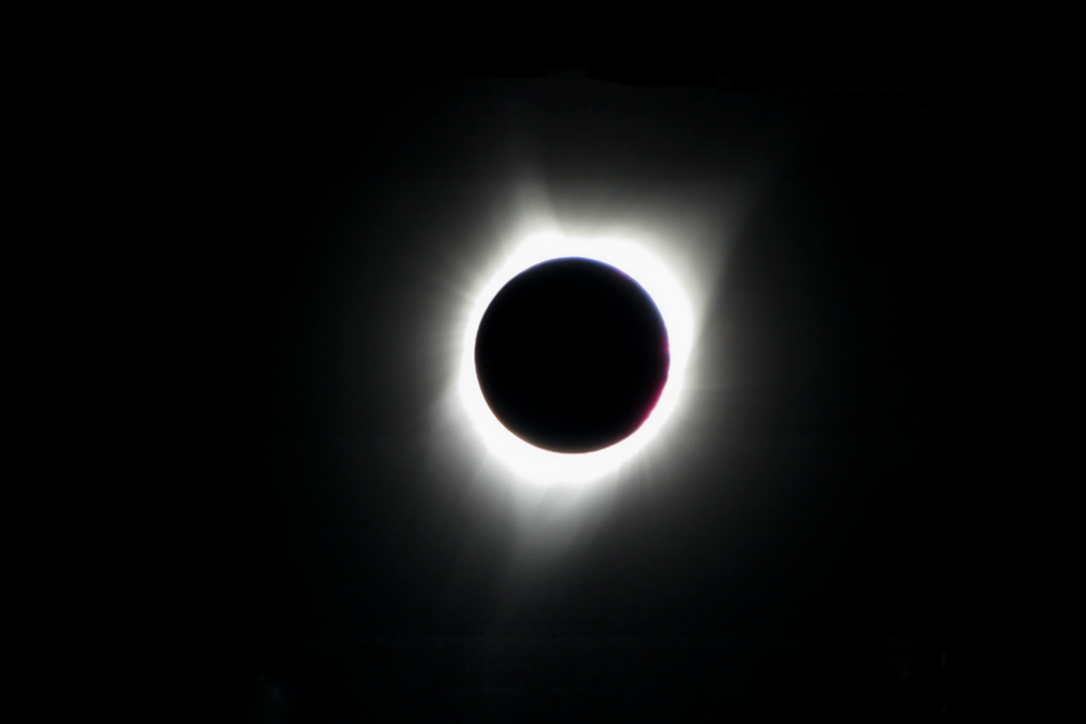 Due to some poor planning on my part, the entirety of the sun was not captured in the original frame. I moved the camera and later combined 40 frames from the video to generate this complete image as well as remove noise and refine detail.  Canon PowerShot SX1 IS
