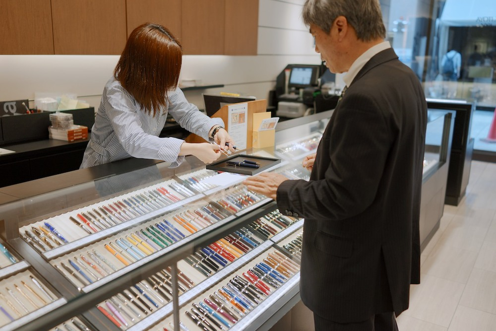 Buying pens at Ginza.