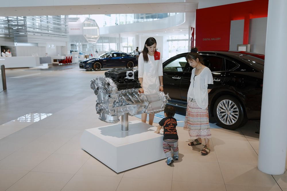 Vistors and an attendant at the Yokohama Nissan Gallery.