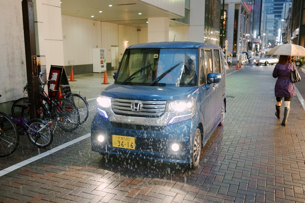 Notice how kei cars have differentiated yellow license plates. Honda N BOX Custom shown.