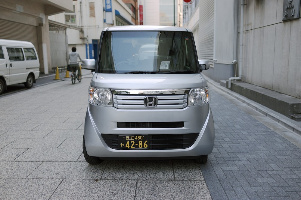 Kei vehicles for commercial use receive inverted colors. Honda N BOX shown.