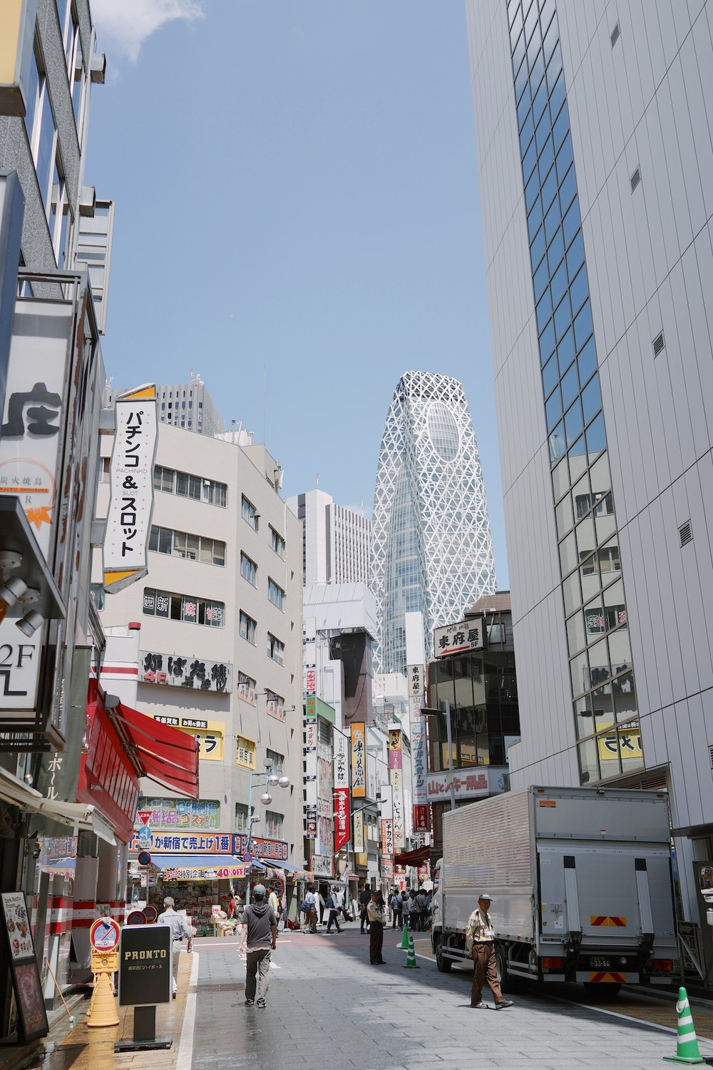 Streets of Shinjuku with the  Mode Gakuen Cocoon Tower  in the background.