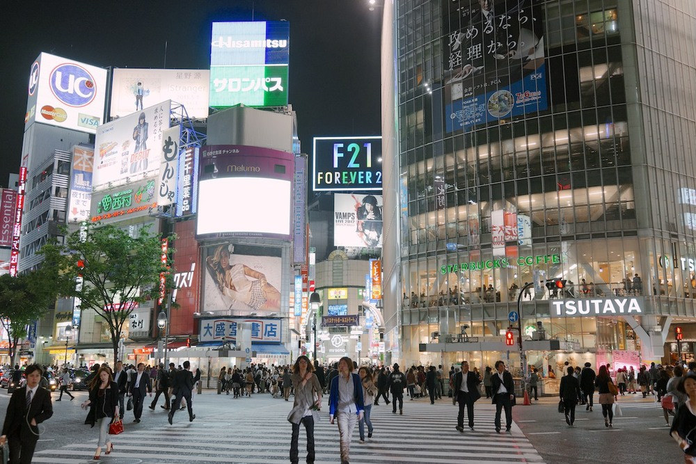 The Shibuya crossing at night.