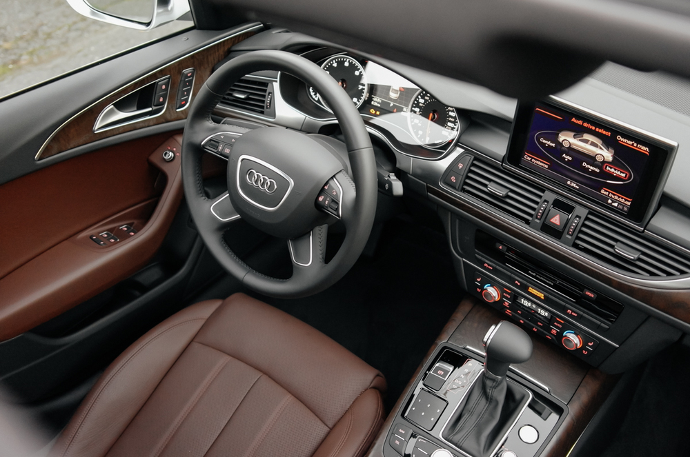 I find black interiors a bit drab so like to have the leather surfaces in a  lighter color, but also dislike going all the way to beige. Audi offers  this ...