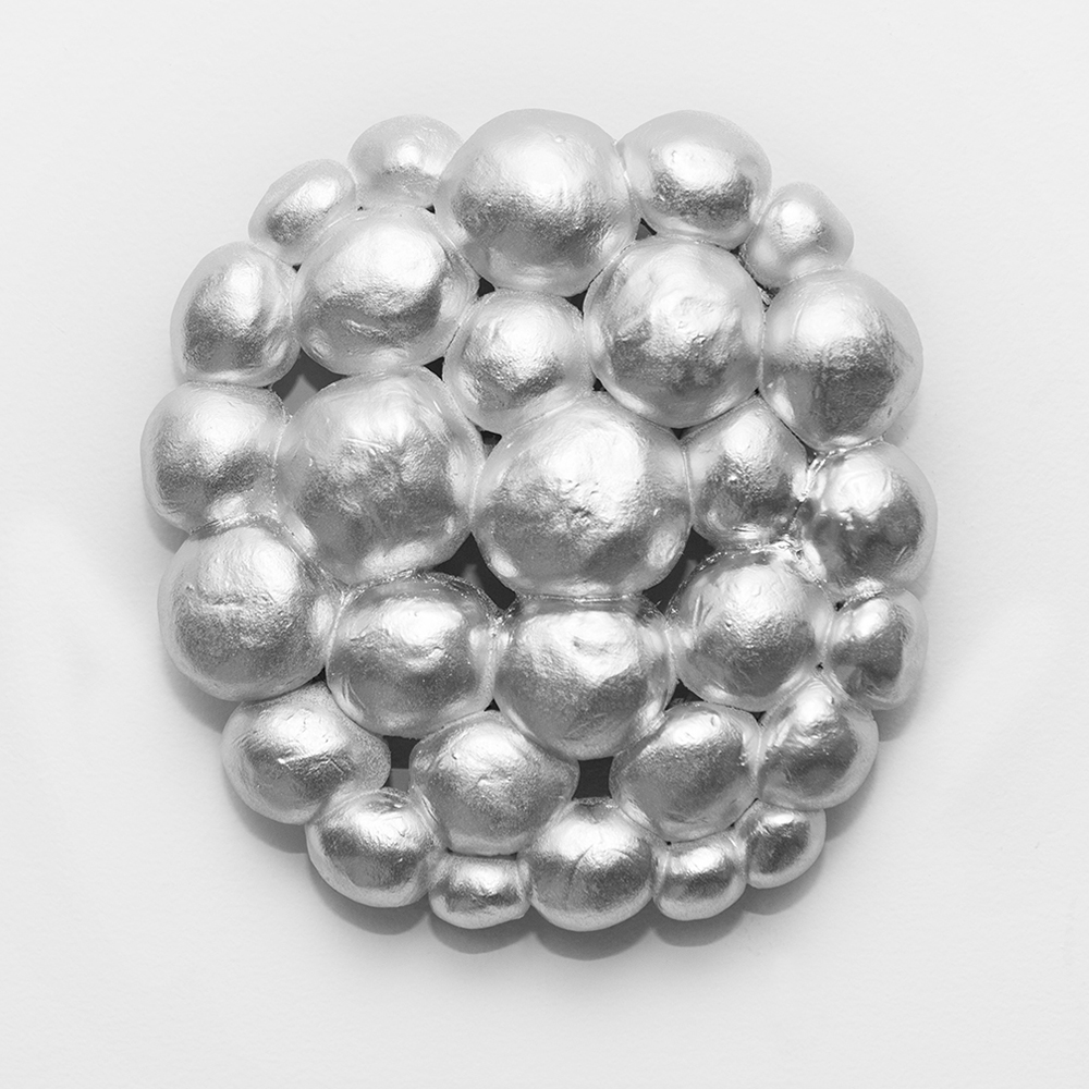 Silver Balls, 2015, Spray paint and fired ceramic form, 12 x 12 inches