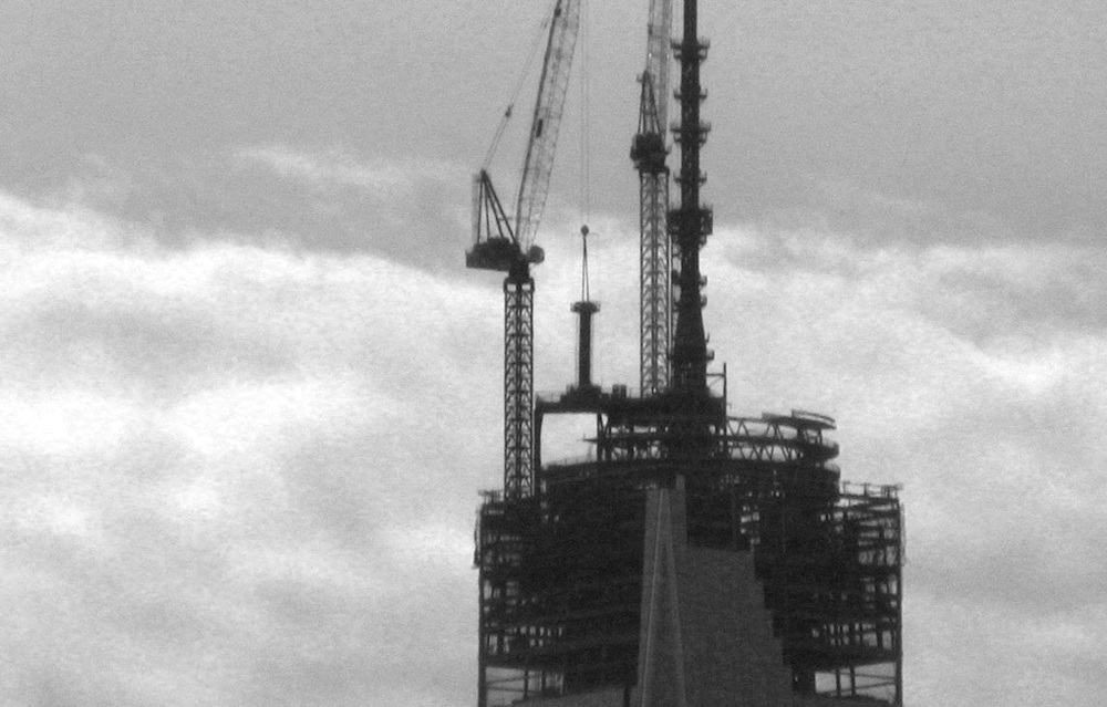 Section 319 of the Spire of the World Trade Center is positioned into place, April 2013