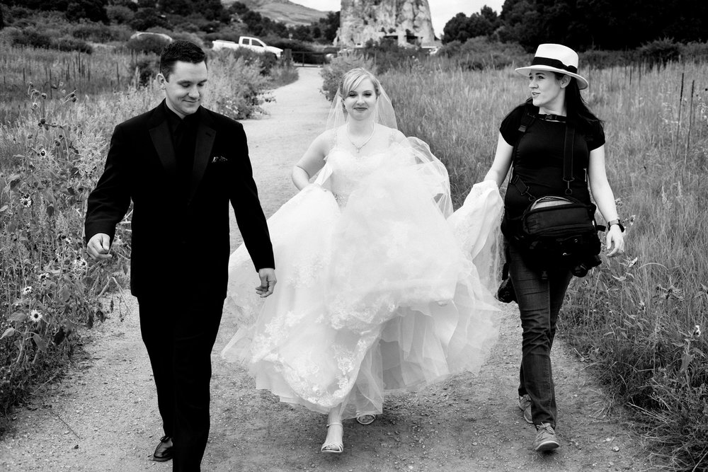 Me walking with Candace and Justin to the perfect portrait spot on their wedding day at Garden of the Gods in Colorado Springs.