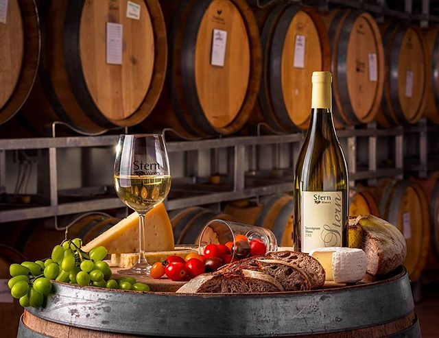 Advertisement image shot on location for Stern Winery // Photo by Itai Aviran . #wine #whitewine #winery #israel #galilee #israeliwine #commercialphotography #foodphotography #studiolighting #onlocation #tuval #nikon #advertisingphotography #light #reflections #grapes #cheese #strobist #nikkor
