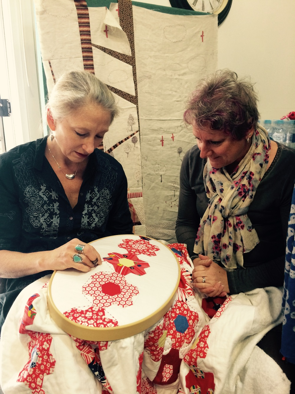 Kathy teaching Viv some hand quilting techniques