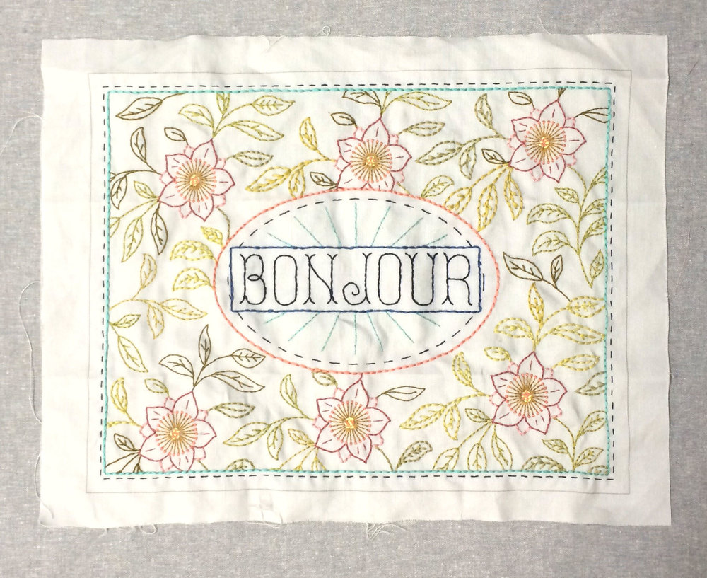 My 'Bonjour' sampler waiting to be made into a cushion.