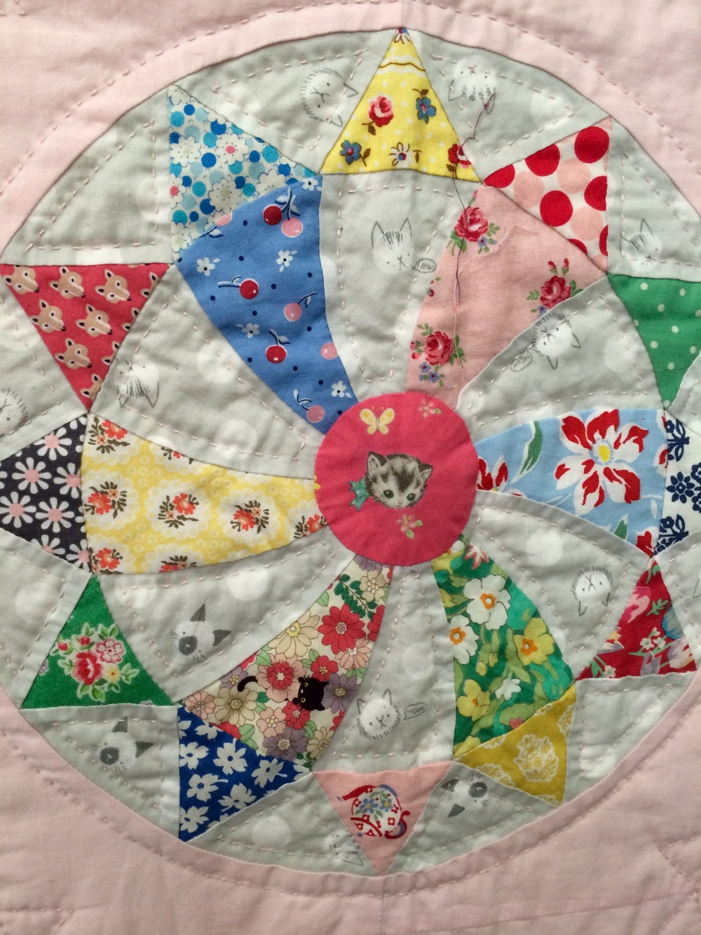 A block from Judy Newman's Sugar Plum Quilt. The little Frou Frou birds would work in beautifully in a block like this.