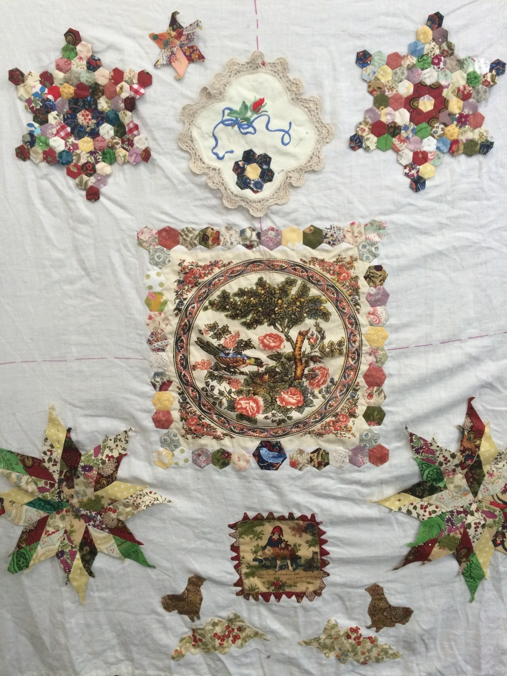 Darilyn's quilt top is in progress and includes vintage fabrics and keepsakes.