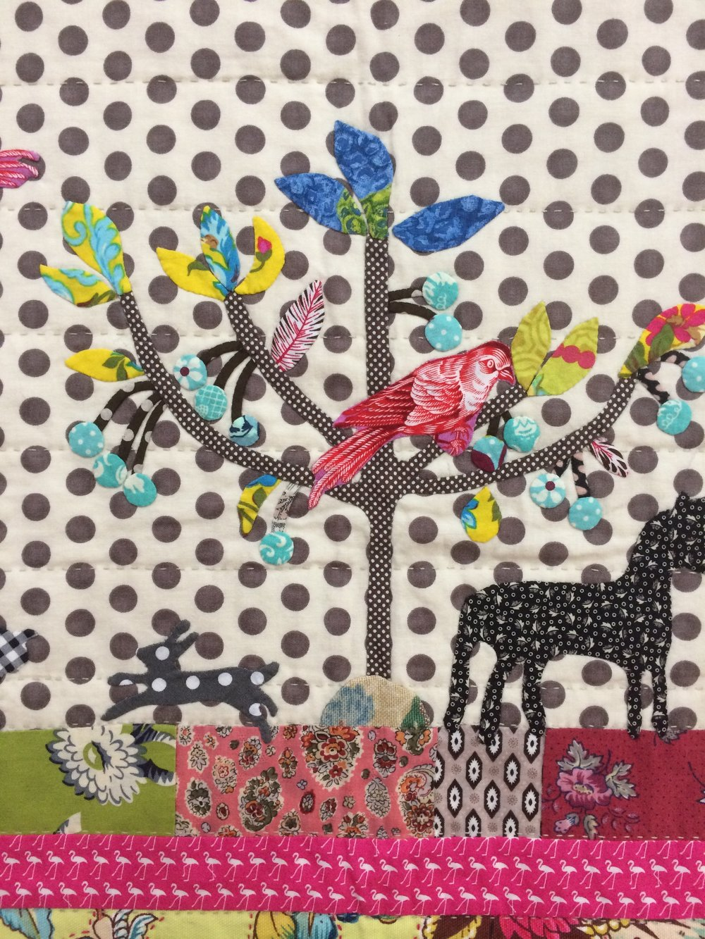 I love the leggy flamingoes and contrast in spots. This is one of Marg's quilts.