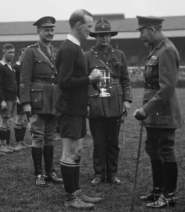 New Zealand captain James Ryan receiving the King's Cup from George V