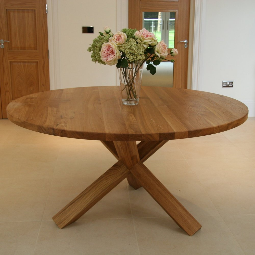 A solid Oak round table with a stunning x- leg . Available in two colours, light oak lacquer  and a grey wash lacquer. Available in 140cm & 150cm diameter, which will seat 6-7, and 7-8 respectively.
