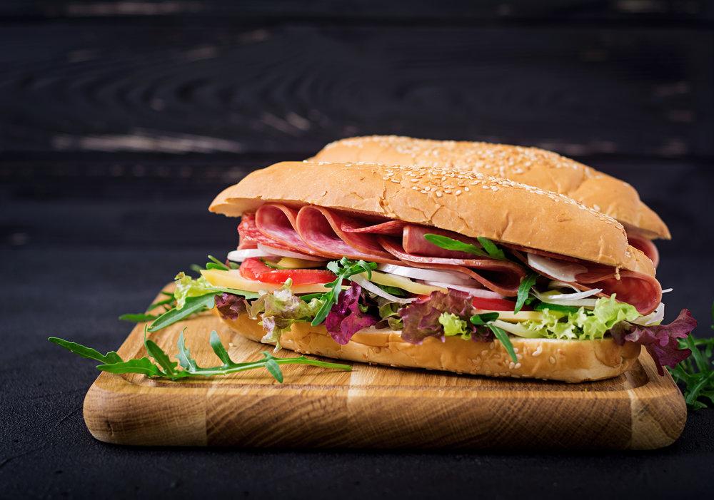 big-sandwich-with-ham-salami-tomato-cucumber-and-P6G738F 2.jpg
