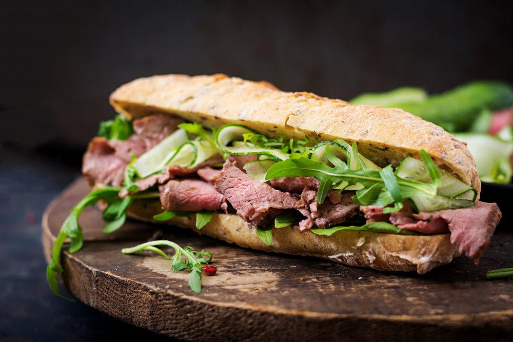 sandwich-of-whole-wheat-bread-with-roast-beef-PH5B6YA.jpg
